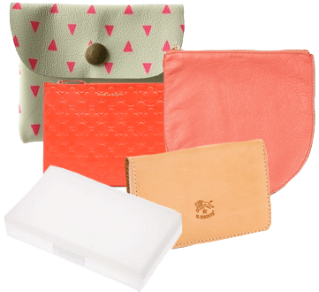 A sea of pouches--Comme Des Garcons clover pouch, Baggu Leather Pouch, Falconwright Pouch, Tokyo Coin Purse, Muji Hair-pin holding box